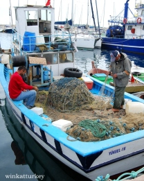 Pescadores en el Iskele de Urla.